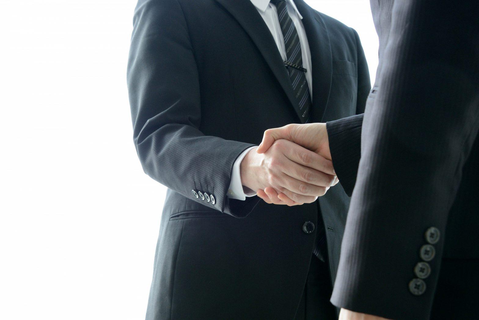 労働者代表と事業主の協定締結イメージの握手